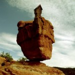 Compassion collage - a house growing from a precariously balanced rock